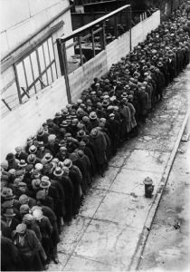 Men waiting in a line for the possibility of a job during the Depression - 1930